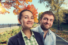 Man and woman smiling Stock Images