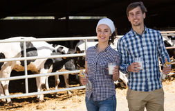 Man and woman smiling with milk Royalty Free Stock Images