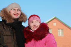 Man and woman smiling in winter outdoors Royalty Free Stock Images