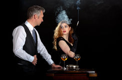 Man woman smoke wine bar royalty free stock images