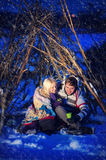Man and woman in the snow in winter in a hut, love Royalty Free Stock Photography