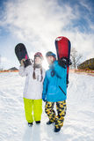 Man and woman with snowboards Stock Images