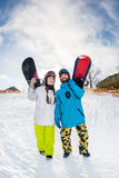 Man and woman with snowboards Royalty Free Stock Images