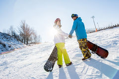 Man and woman with snowboards Stock Image