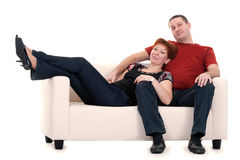 Man and woman on a sofa Royalty Free Stock Photo