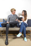 Man and woman on a sofa, surfing online together Royalty Free Stock Photos