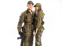 Man and woman in soldier`s suit on white background. royalty free stock photos
