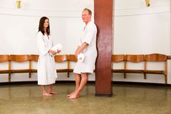 Man and Woman in Spa Recption. A smiling man and woman looking at the camera in a funkus styled spa Stock Image