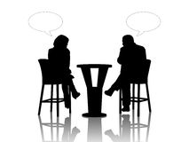 Man and woman speaking at the table in a cafe Stock Image