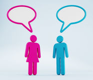 Man and woman with speech balloons Stock Images