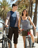 Man and woman spending a holidays with bicycles Royalty Free Stock Photography