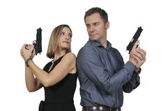 Man and woman spies. Man and women secret agent spies with guns Royalty Free Stock Photos