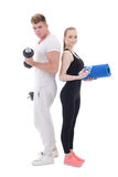Man and woman in sportswear with dumbbells and yoga mat isolated Royalty Free Stock Images