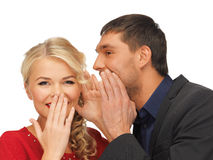 Man and woman spreading gossip. Bright picture of men and women spreading gossip (focus on woman royalty free stock images