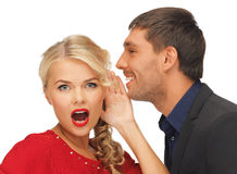 Man and woman spreading gossip. Bright picture of men and women spreading gossip (focus on woman royalty free stock photos
