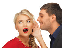 Man and woman spreading gossip Stock Photography