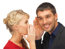 Man and woman spreading gossip. Man and women spreading gossip (focus on man royalty free stock image