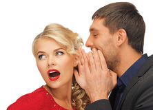 Man and woman spreading gossip Royalty Free Stock Photography