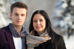 Man and woman stand in scarfs in the winter outdoors Stock Photo