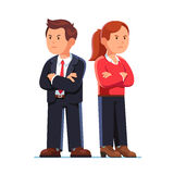 Man and woman standing back to back after argument. Angry man and woman turning away from each other crossing their arms. Standing back to back after argument Royalty Free Stock Images
