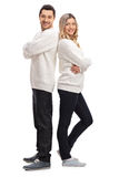 Man and a woman standing back to back Royalty Free Stock Photo