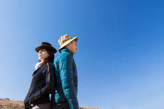 Man and Woman Standing Back to Back Outdoors Royalty Free Stock Image