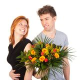 Man and woman standing backwards with a beautiful bunch of flowers Stock Photo