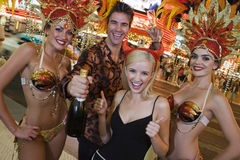 Man And Woman Standing With Casino Dancers Royalty Free Stock Images
