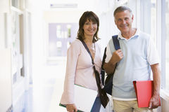A man and woman standing in a corridor Royalty Free Stock Photo