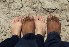 Man and Woman standing on cracked earth, California Stock Image
