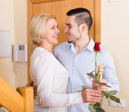 Man and woman standing at doorway Stock Photography
