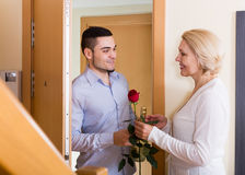 Man and woman standing at doorway Royalty Free Stock Photos