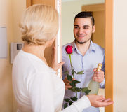 Man and woman standing at doorway Stock Images