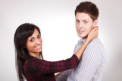 Man and woman standing embraced Stock Images