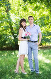 Man and woman standing on the grass Stock Image