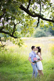 Man and woman standing in the grass Stock Photography