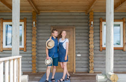 Man and woman standing at home with a large wooden window, the event concept of a young family,. Man and women standing at home with a large wooden window, the stock image
