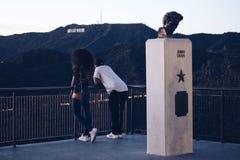 Man and Woman Standing Near Black Metal Railings Stock Photos