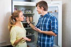Man and woman standing near fridge Royalty Free Stock Photo