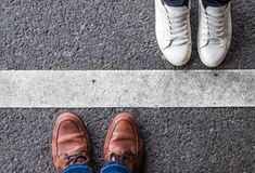 Couple divided by a white line stock photo