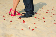 Man and woman standing on the sand Royalty Free Stock Photos