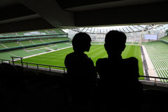 Man and woman standing and talking on stadium Royalty Free Stock Images