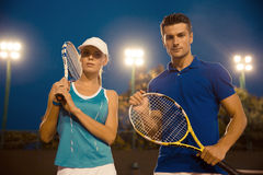 Man and woman standing at tennis court Royalty Free Stock Photo