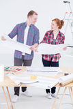 Man and the woman standing together close to the drafting board Royalty Free Stock Photography