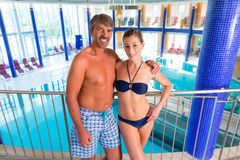 Man and woman standing in wellness thermal spa Stock Image
