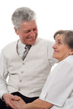 Man and woman staring at each. Elderly man and woman staring at each other white background Stock Photos