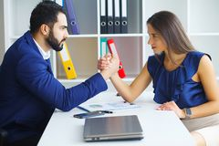 Man and woman staring at each other with hostile expressions. Man and women staring at each other with hostile expressions royalty free stock image