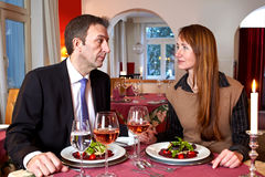 Man and woman staring at each over a meal Stock Photo