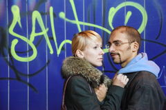 Man and woman is staying near graffiti wall royalty free stock photography