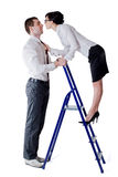 Man woman and stepladder Royalty Free Stock Photography